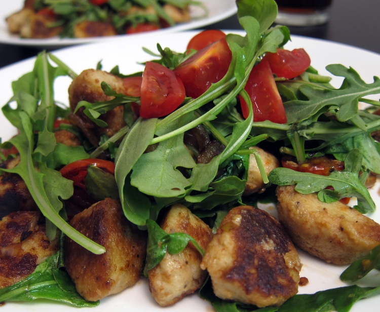 Cauliflower Gnocchi with Arugula and Tomatoes Dish