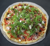 top with tomatoes, olives, feta, arugula and bake for 10 minutes